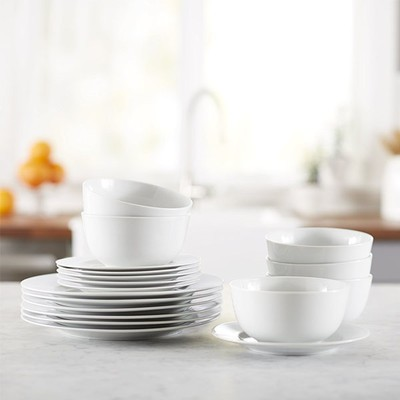 & Set your dinner table with the $26 AmazonBasics 18-piece Dinnerware Set
