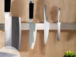 Spend $12 on this magnetic knife holder and you'll feel like Alton Brown