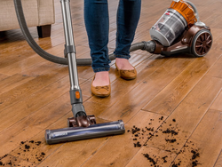 Bissell's $130 Hard Floor Expert Canister Vacuum is an appropriate fit for tile, hardwood, rugs, and more