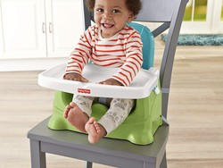 Give your kid a safe place to sit and eat with this discounted Fisher-Price booster seat