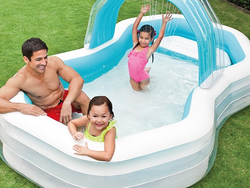 Take a dip in this $16 water-spraying Family Cabana Inflatable Pool