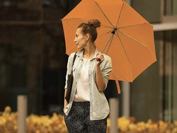 The Lewis N. Clark compact travel umbrella is on sale for $10 in orange and red