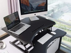 The $110 TaoTronics standing desk converter transitions smoothly between sitting and standing