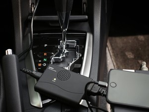 Aukey's compact power inverter adds a 120W AC outlet and USB port to your car
