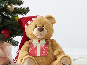 Amazon gift cards of $100 or more ship with a free Gund Teddy Bear this holiday season