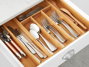 Corral your cutlery with this $13 AmazonBasics Bamboo Drawer Organizer