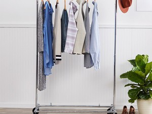 Create space for your clothes with this $20 AmazonBasics Garment Rack