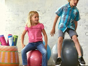 Funnel that boundless energy into one of these $16 Gaiam yoga ball chairs for kids