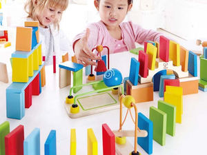 These $26 Dynamo Wooden Dominoes were made to be lined up and knocked down