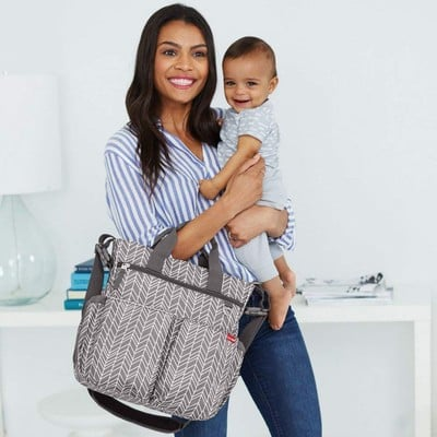 This $32 Skip Hop Messenger Diaper Bag comes with a matching changing pad